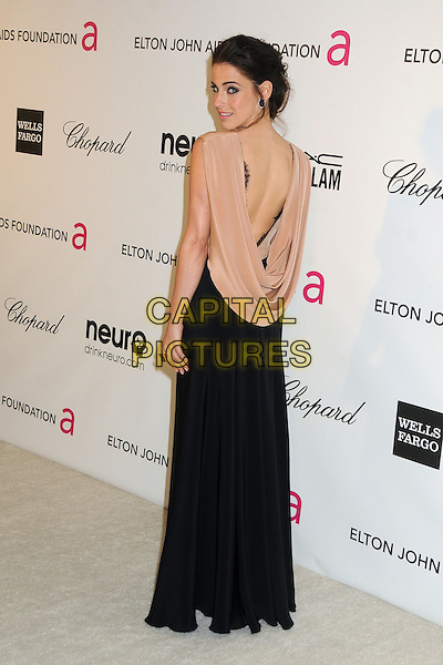 Jessica Lowndes.21st Annual Elton John Academy Awards Viewing Party held at West Hollywood Park, West Hollywood, California, USA..February 24th, 2013.oscars full length dress beige sheer sleeveless black skirt clutch bag cowl back draped back behind rear looking over shoulder .CAP/ADM/BP.©Byron Purvis/AdMedia/Capital Pictures.