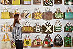 "Pictured: Exhibition visitor Sarah Bull admires some of the handbags on display at the Orla Kiely exhibition.<br /> <br /> An exhibition of fashion and textile pieces by OBE awarded designer Orla Kiely is currently on display at the Winchester Discovery Centre in Hampshire.  <br /> <br /> ""Orla Kiely: A Life in Pattern"" features unique and colourful clothing alongside giant hanging dresses, all emblazoned with unique and iconic patterns created by the world renowned designer.<br /> <br /> The main attraction of the show is a feature wall displaying 100 handbags designed owned and sold by Orla Kiely.  The handbags feature a wide range of designs including her iconic ""Stem"" design.   <br /> <br /> The show continues until January 5th, 2020. <br /> <br /> © Morten Watkins/Solent News & Photo Agency<br /> UK +44 (0) 2380 458800"