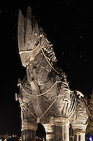 Model of the Trojan horse from the 2004 film Troy, directed by Wolfgang Petersen, seen at night, preserved on the seafront at Canakkale, Turkey. Canakkale is on the southern (Asian) coast of the Dardanelles and is the nearest city to the archaeological site of Troy. The original Trojan horse was said to be used by the Greeks to capture the city of Troy from the Trojans during the Trojan War. Greek soldiers hid inside the body of the horse which was pulled into the besieged city by the Trojans, who believed the Greeks to have retreated. Picture by Manuel Cohen
