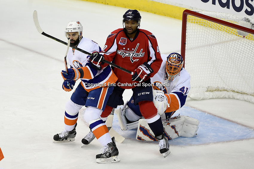 April 23, 2015 - Washington D.C., U.S. -  Washington Capitals right wing Joel Ward (42) works between New York Islanders defenseman Brian Strait (37) and goalie Jaroslav Halak (41)  during game 5 of the  NHL Eastern Conference Quarter finals between the New York Islanders and the Washington Capitals held at the Verizon Center in Washington DC.  The Capitals defeat the Islanders 5-1 in regulation time to take the lead in the 7 game series 3-2. Eric Canha/CSM