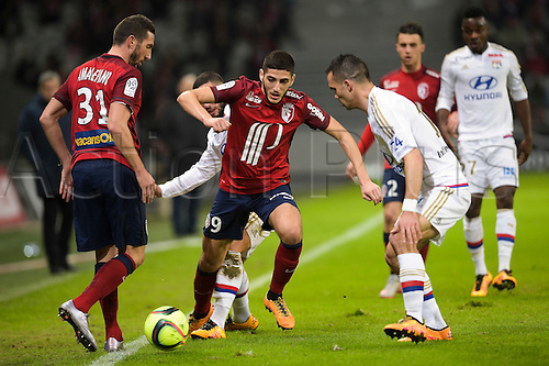 21.02.2016. Lille, France. French League 1 football. Lille versus Lyon.  Yassine Benzia (Losc) challenged by FERRI Jordan and MOREL Jeremy (Lyon)