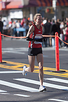 NEW YORK - NOVEMBER 7: Anne-Sofie Hansen of Denmark approaches the 8 mile mark on 4th avenue in the 2010 New York City Marathon. Hansen finished 35th in 2:45:36.