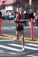 NEW YORK - NOVEMBER 7: Anne-Sofie Hansen of Denmark approaches the 8 mile mark on 4th avenue in the 2010 New York City Marathon. Hansen finished 35th in 2:45:36.