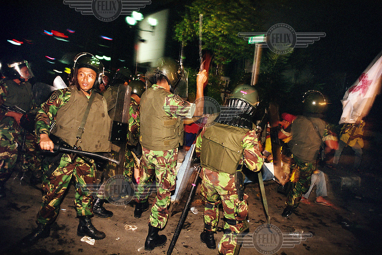Members of the military clash with demonstrators on what became known as 'Black Friday' when at least 16 people were killed and around 400 were wounded during a night-long attempted march on parliament by anti-government protestors.