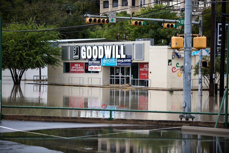 Flash Flooding closed many roads and low water crossings in downtown Austin after severe weather slammed central Texas.