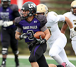 SIOUX FALLS, SD - OCTOBER 18: Nephi Garcia #53from the University of Sioux Falls scampers for yardage past Casey Hertz #11 from Southwest Minnesota State in the first half of their game Saturday afternoon at Bob Young Field in Sioux Falls. (Photo by Dave Eggen/Inertia)
