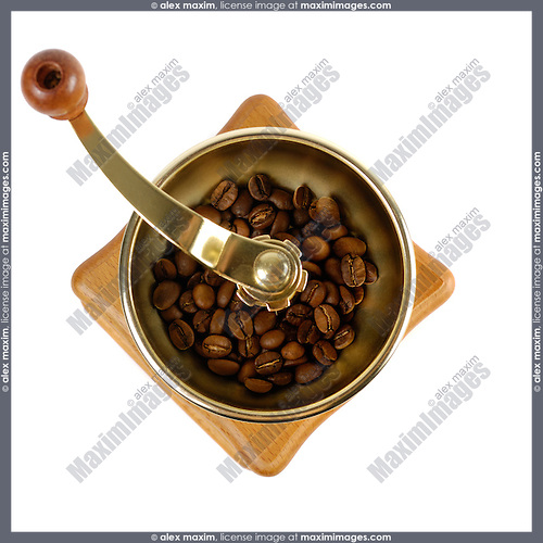 Coffee grinder with coffee beans close-up Isolated over white background