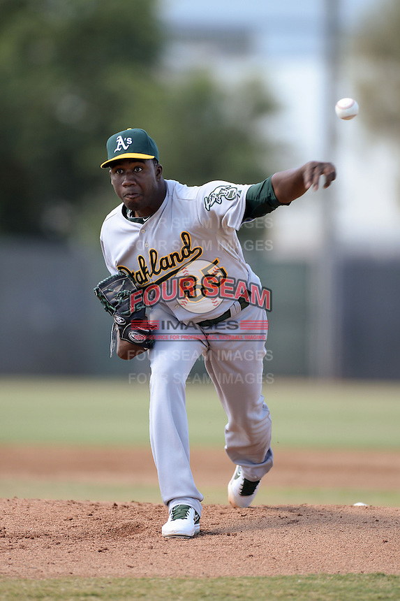 Oakland Athletics pitcher Pedro Figueroa (65) during an Instructional League game against the Milwaukee Brewers on October 10, 2013 at Maryvale Baseball Park Training Complex in Phoenix, Arizona.  (Mike Janes/Four Seam Images)