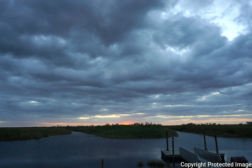 Heavy clouds approach the everglades at sunset signaling a major rainstorm. <br />