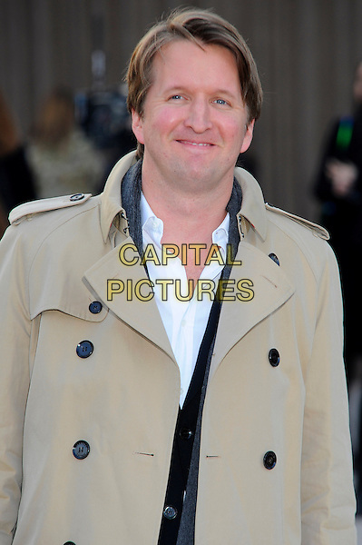 Tom Hooper.Arrivals to London Fashion Week's Autumn/Winter 2013 Burberry Prorsum show, Hyde Park, London, England. 18th February 2013.LFW half length beige coat white shirt .CAP/CJ.©Chris Joseph/Capital Pictures.