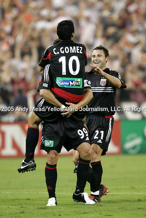 15 July 2005: Christian Gomez (10) celebrates his second goal of the game with Jaime Moreno (99) and Dema Kovalenko. DC United defeated the San Jose Earthquakes 3-0 at RFK Stadium in Washington, DC in a regular season Major League Soccer game.