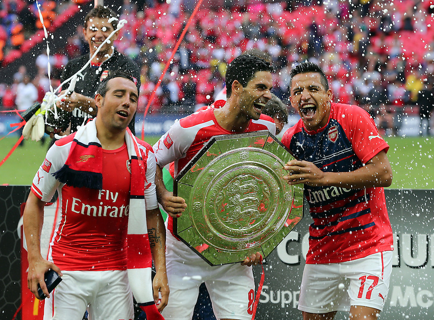 Arsenal's Santi Cazorla,Arsenal's Mikel Arteta and Arsenal's Alexis S&aacute;nchez with the FA Community Shield<br /> Photographer Kieran Galvin/CameraSport<br /> <br /> Football Friendly - FA Community Shield - Arsenal v Manchester City - Sunday 10th August 2014 - Wembley - London<br /> <br /> &copy; CameraSport - 43 Linden Ave. Countesthorpe. Leicester. England. LE8 5PG - Tel: +44 (0) 116 277 4147 - admin@camerasport.com - www.camerasport.com
