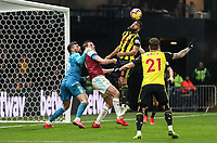 Burnley's Chris Wood is held back by Watford's Ben Foster as Watford's Adrian Mariappa heads clear<br /> <br /> Photographer Andrew Kearns/CameraSport<br /> <br /> The Premier League - Watford v Burnley - Saturday 19 January 2019 - Vicarage Road - Watford<br /> <br /> World Copyright © 2019 CameraSport. All rights reserved. 43 Linden Ave. Countesthorpe. Leicester. England. LE8 5PG - Tel: +44 (0) 116 277 4147 - admin@camerasport.com - www.camerasport.com