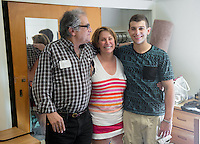 First-year Nick Mayer '18 gets a hug from his parents Bob and Edie Mayer after moving into Stewart-Cleland Hall (Stewie) during Occidental College Orientation, Aug. 22, 2014. (Photo by Marc Campos, Occidental College Photographer)
