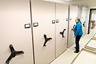 November 7, 2017; Barbara J. Hellenthal, Biodiversity Museum & Herbarium Curator, looks up samples in the herbarium in Jordan Hall of Science. (Photo by Matt Cashore/University of Notre Dame)