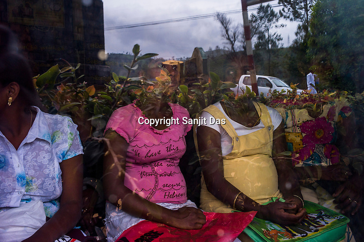 Tea plantation workers wait at the local dispensary and health clinic in Eskdale Tea Estate in Nuwareliya in Central Sri Lanka.  Photo: Sanjit Das/Panos