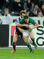 15th March 2014; Brian O'Driscoll, Ireland, is tackled by Maxime Medard, France. RBS Six Nations, France v Ireland, Stade de France, St Denis, Paris. Picture credit: Tommy Grealy/actionshots.ie.