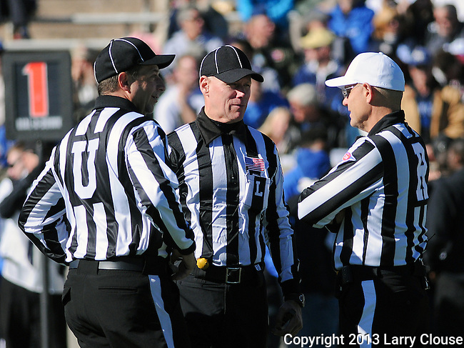 November 2, 2013 - Colorado Springs, Colorado, U.S. - <br /> Game officials, Umpire, Jim Eckl, Line Judge, Hugh Campbell, and Referee, Jeff Flanagan, during a military academy match-up between the Army Black Knights and the Air Force Academy Falcons at Falcon Stadium, U.S. Air Force Academy, Colorado Springs, Colorado.  Air Force defeats Army 42-28