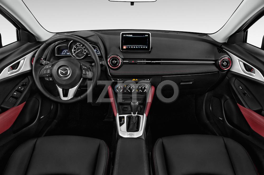 Stock photo of straight dashboard view of 2016 Mazda CX3 Skydrive 5 Door Suv Dashboard