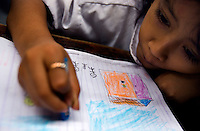 A kindergarten student at the Kartini Emergency School during a drawing class. Since the early 1990s, twin sisters Sri Rosyati (known as Rossy) and Sri Irianingsih (known as Rian) have used their family inheritance to set up and run 64 schools in different parts of Indonesia, providing primary education combined with practical skills to some of the country's most deprived children.