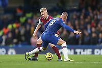 Burnley's Ben Mee and Chelsea's Ross Barkley<br /> <br /> Photographer Rob Newell/CameraSport<br /> <br /> The Premier League - Chelsea v Burnley - Saturday 11th January 2020 - Stamford Bridge - London<br /> <br /> World Copyright © 2020 CameraSport. All rights reserved. 43 Linden Ave. Countesthorpe. Leicester. England. LE8 5PG - Tel: +44 (0) 116 277 4147 - admin@camerasport.com - www.camerasport.com
