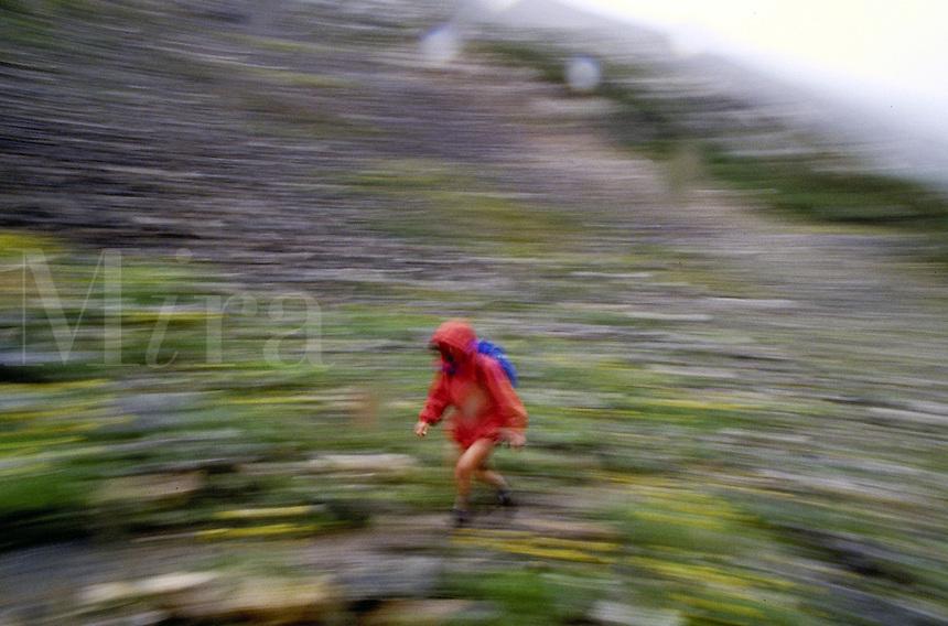 Lisa Fite (MR295) hiking in the rain, Colorado. Lisa Fite (MR295). Summit County, Colorado.