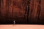 Hiker in desert canyon, Coyote Gulch, Grand Staircase-Escalante National Monument, Utah