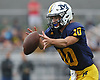 Kenny Galvin #10, Massapequa quarterback, takes a snap during a Nassau County Conference I varsity football game against Farmingdale at Massapequa High School on Saturday, Sept. 22, 2018. Farmingdale won by a score of 41-27.