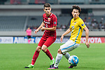 Jiangsu FC Midfielder Xie Pengfei (R) in action against Shanghai FC Forward Oscar Emboaba Junior (L) during the AFC Champions League 2017 Round of 16 match between Shanghai SIPG FC (CHN) vs Jiangsu FC (CHN) at the Shanghai Stadium on 24 May 2017 in Shanghai, China. Photo by Marcio Rodrigo Machado / Power Sport Images