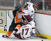 Ben Geelan 22 of Bowling Green falls on Joe Rooney 17 of Boston College while trying to get the puck from Andrew Orpik 27 of Boston College. The Eagles of Boston College defeated the Falcons of Bowling Green State University 5-1 on Saturday, October 21, 2006, at Kelley Rink of Conte Forum in Chestnut Hill, Massachusetts.<br />