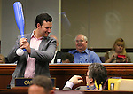 Nevada Assemblymen Stephen Silberkraus, R-Henderson, left, and Richard Carrillo, D-Las Vegas, talk about at a prank gift left on his desk at the Legislative Building in Carson City, Nev., on Sunday, May 31, 2015.  <br /> Photo by Cathleen Allison
