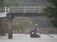 "Almost zero visibility during a heavy Monsoon rain storm near near Can Tho, the hub of the Mekong Delta (Vietnamese: Đồng bằng Sông Cửu Long ""Nine Dragon river delta""), also known as the Western Region (Vietnamese: Miền Tây or the South-western region (Vietnamese: Tây Nam Bộ) is the region in southwestern Vietnam where the Mekong River approaches and empties into the sea through a network of distributaries. The Mekong delta region encompasses a large portion of southwestern Vietnam of 39,000 square kilometres (15,000 sq mi). The size of the area covered by water depends on the season.<br />