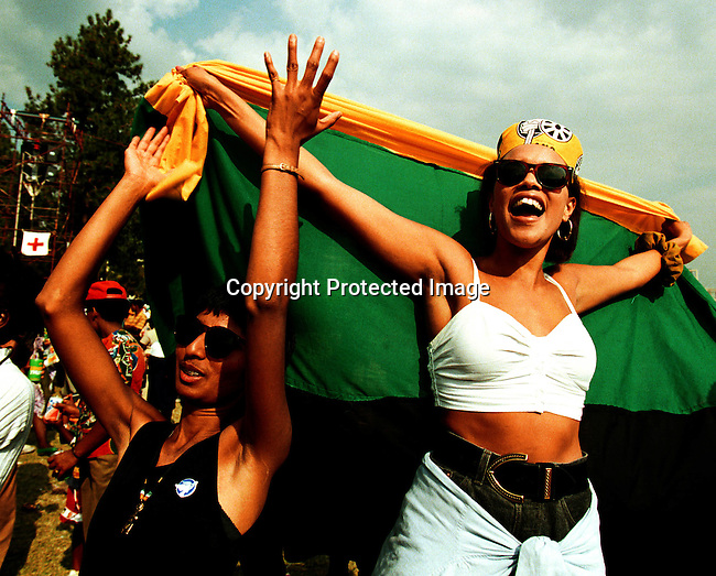 DIELECT00083.Polotics. Elections. South Africans celebrating the inaguration of President Nelson Mandela in Pretoria in early March 1994. South Africans voted in the first democratic election after Apartheid on February 27 1994; 2 female ANC supporters..©Per-Anders Pettersson@iAfrika Photos
