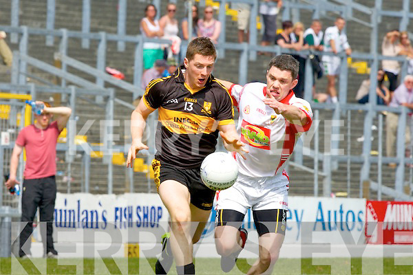 Kieran O'Leary goes past John Sheehan East Kerry during their county Championship clash in Killarney on Sunday