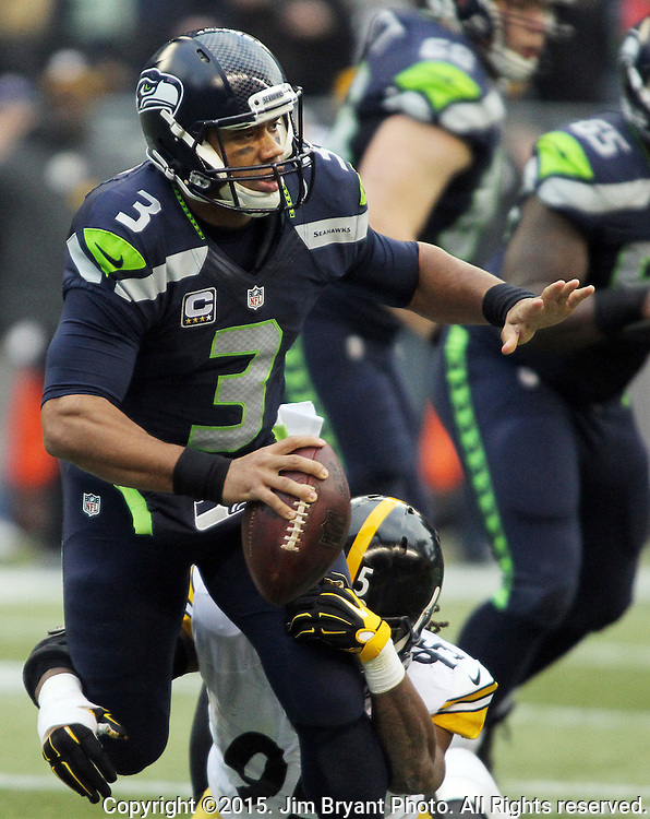 Seattle Seahawks quarterback Russell Wilson (3) looks to pass before being brought down by Pittsburgh Steelers linebacker Jarvis Jones (95) at CenturyLink Field in Seattle, Washington on November 29, 2015.  The Seahawks beat the Steelers 39-30.      ©2015. Jim Bryant Photo. All Rights Reserved.
