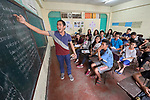 "Larren Jo ""LJ"" Bacilio (left), a teacher in the Alternative Learning System of the Kapatiran-Kaunlaran Foundation (KKFI), talks with his students during a class in the Tondo neighborhood of Manila, Philippines. <br /> <br /> KKFI is supported by United Methodist Women."