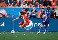 26 April 2009: Kansas City Wizards forward Josh Wolff #16 and Toronto FC forward Pablo Vitti #8 collide at BMO Field in Toronto in a  game between Kansas City Wizards and Toronto FC..Toronto FC won 1-0.