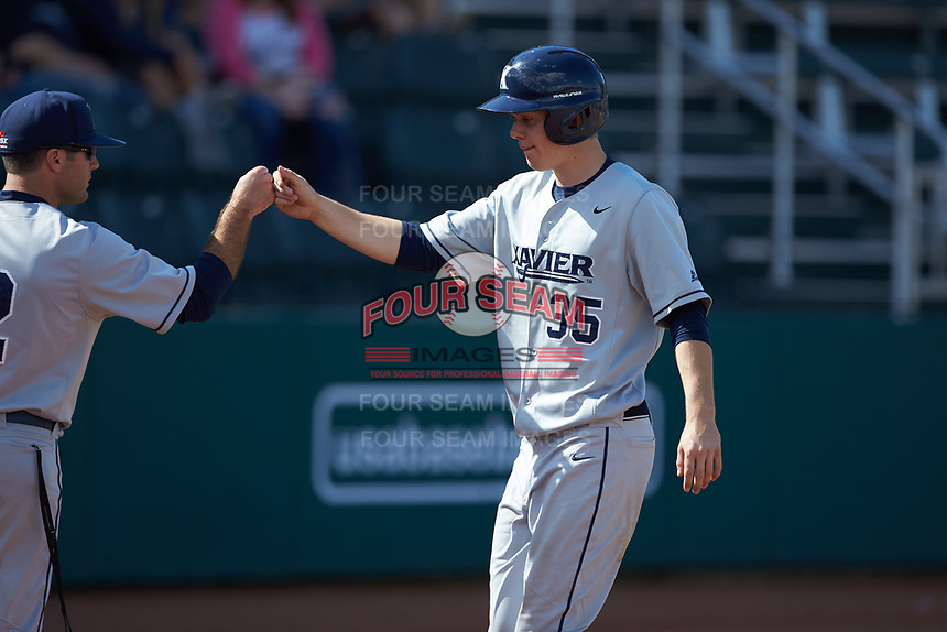 Chris Givin (35) of the Xavier Musketeers celebrates a run against the Penn State Nittany Lions at Coleman Field at the USA Baseball National Training Center on February 25, 2017 in Cary, North Carolina. The Musketeers defeated the Nittany Lions 10-4 in game one of a double header. (Brian Westerholt/Four Seam Images)