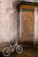 Tarnished coffee plantation doorway on the Bolaven Plateau in Laos