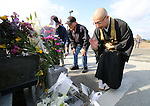 March 11, 2016, Tokyo, Japan - A Buddhist monks  and local residents offer prayers before a small altar on for the victims of tsunami and earthquake on the area destroyed by the tsunami at Namie in Fukushima prefecture near the crippled TEPCO nuclear plant on Friday, March 11, 2016 on the fifth anniversary of the Great East Japan Earthquake and Tsunami.  (Photo by Yoshio Tsunoda/AFLO)