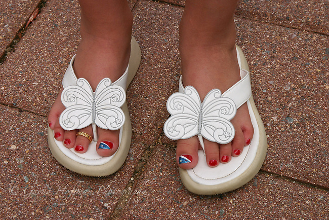 Nail polish, toe ring, butterfly flip flops.