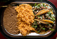 Photos of a carnitas taco dish with rice and beans at Taqueria Pedrito in Dallas, Texas, Thursday, September 3, 2009. Taqueria Pedrito was the first taqueria established in Dallas and opened in the 1970s...MATT NAGER/ SPECIAL CONTRIBUTOR
