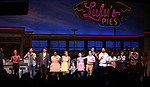 Ben Thompson, Steve Vinovich, NaTasha Yvette Williams, Katie Grober, Caitlin Houlahan, Christopher Fitzgerald, Drew Gehling and Benny Elledge with Katharine McPhee during her Broadway Debut Curtain Call in 'Waitress' at the Brooke Atkinson Theatre on April 10, 2018 in New York City.