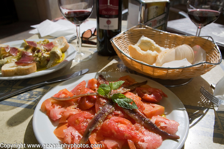 Tomato anchovy salad meal on table, Ronda, Spain