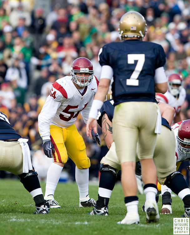 10/17/09 - South Bend, IN:  USC linebacker Chris Galippo eyes Notre Dame quarterback Jimmy Clausen at Notre Dame Stadium on Saturday.  USC won the game 34-27 to extend its win streak over Notre Dame to 8 games.  Photo by Christopher McGuire.