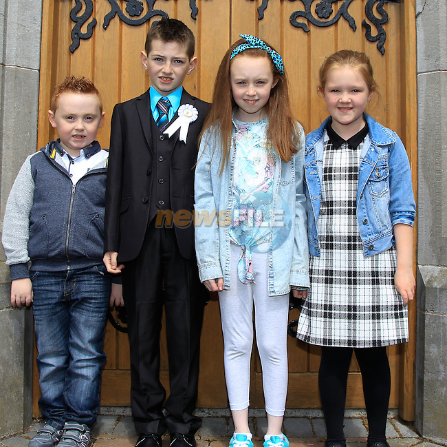 Matthew James Murphy with Finn, Erin and Abbie during Communion in Church of Mary Immaculate, Collon on Saturday 9th May 2015.<br /> Picture:  Thos Caffrey / www.newsfile.ie