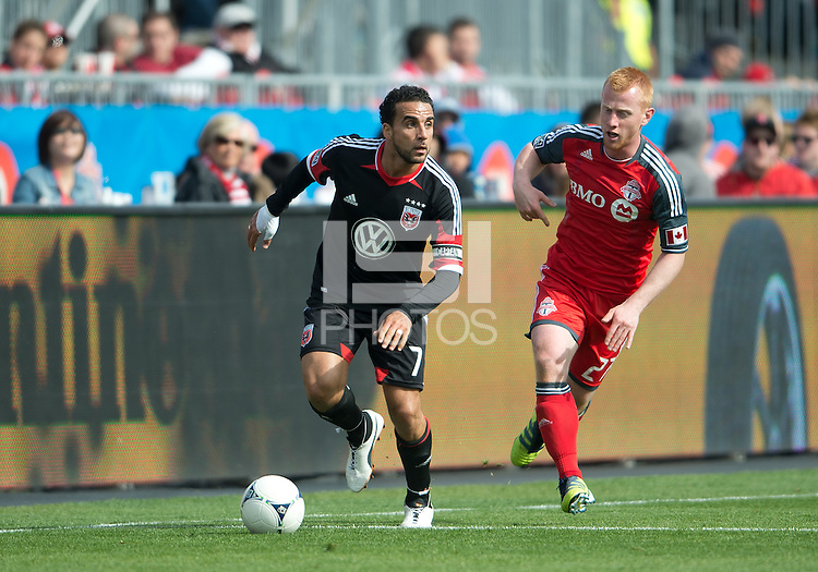 05 May 2012: D.C. United midfielder Dwayne De Rosario #7 and Toronto FC defender Richard Eckersley #27 in action during an MLS game between DC United and Toronto FC at BMO Field in Toronto.