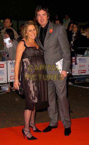LUCY BENJAMIN & RICHARD TAGGART.The Daily Mirror's Pride Of Britain Awards, London Television Studios, London, UK..November 6th, 2006.Ref: CAN.full length black dress sheer grey gray suit husband wife married pregnant.www.capitalpictures.com.sales@capitalpictures.com.©Can Nguyen/Capital Pictures