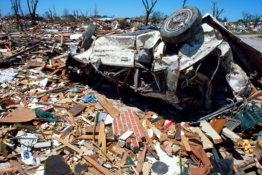 A destroyed vehicle lies in the wreckage of a neighborhood in Moore Oklahoma after the passage of an F-5 tornado on May 3rd, 1999.