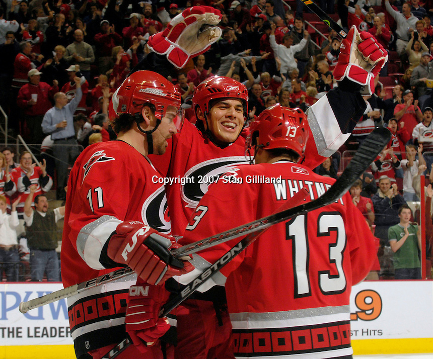 Carolina Hurricanes' defenseman David Tanabe celebrates his first period goal against the New Jersey Devils with teammates Ray Whitney (13) and Justin Williams (11) Thursday, March 15, 2007 at the RBC Center in Raleigh, NC. New Jersey won 3-2.